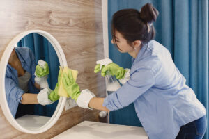 housewife-woking-home-lady-blue-shirt-woman-clean-mirror (1)